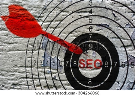 Seo target on grunge background - stock photo