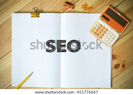 SEO text on paper in the office , business concept