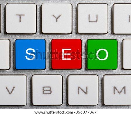 SEO text on the colorful buttons of the keyboard.