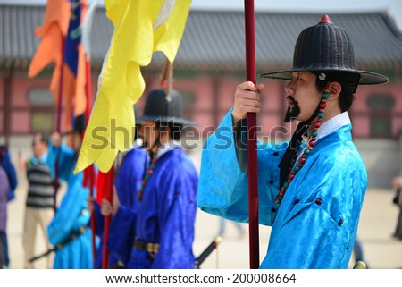 SEOU, SOUTH KOREA - APRIL 13, 2014: The ceremony changing of the guards at the Gyeongbokgung Palace complex in Seoul, Korea. The guards wear colorful uniforms in the pageant.