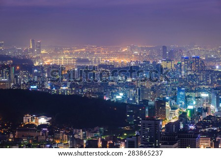 Seoul city and Han river, Downtown skyline in Misty day, South Korea.