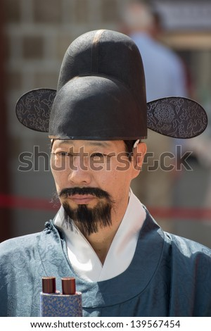 SEOUL KOREA APRIL 21: Deoksugung Palace Royal Guard-Changing Ceremony on April 21 2013 in Seoul. This tradition is similar to the changing of the guard at Buckingham Palace in England. - stock photo