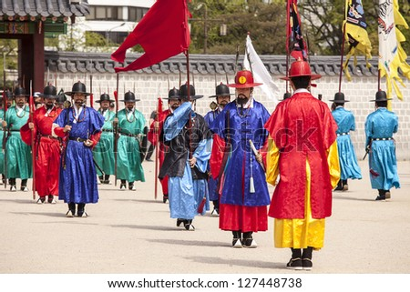SEOUL, KOREA - APRIL 27: The ceremony to change the guards at the Gyeongbokgung Palace complex on April 27, 2012 in Seoul, Korea. The guards wear colorful uniforms in the pageant. - stock photo