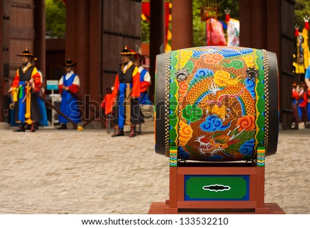 SEOUL, KOREA - AUGUST 27, 2009: A traditional Korean drum rests at the entrance to Deoksugung Palace, a tourist landmark, for changing of the guards ceremony in Seoul, South Korea on August 27, 2009 - stock photo
