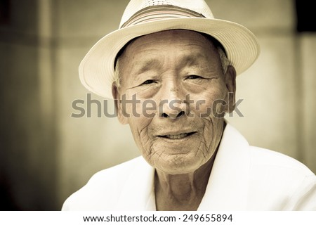 Seoul, Korea - July 2012. An elderly Korean man is in pagoda park in Seoul, Korea in July 2012. - stock photo