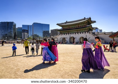 SEOUL, KOREA - OCTOBER 9, 2015 : Gyeongbokgung Palace, Unidentified women wear colorful traditional visit to the palace. The ancient architecture is elegant. and historical value of South Korea. - stock photo