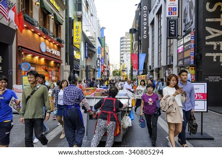 SEOUL, KOREA - OCTOBER 3, 2015 : Myeong-Dong shopping street, Korean people tourists walking shopping the neighbourhood. It is fashionable to be the most popular. neighbourhood is must when traveling. - stock photo