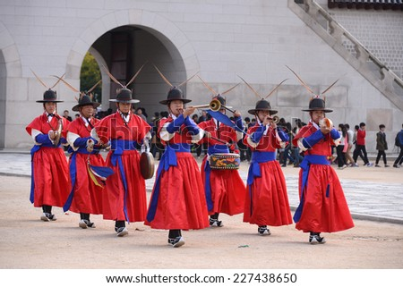 SEOUL, KOREA - OCTOBER 22 : Royal Guard in The Gyeongbokgung Palace in Seoul, Korea on October 22, 2014. - stock photo