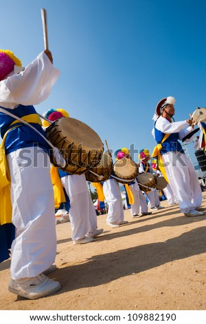 SEOUL, KOREA - SEPTEMBER 18: A group of traditionally dressed Koreans dance and play drums  at a local outdoor festival on September 18, 2009 in Seoul, Korea - stock photo
