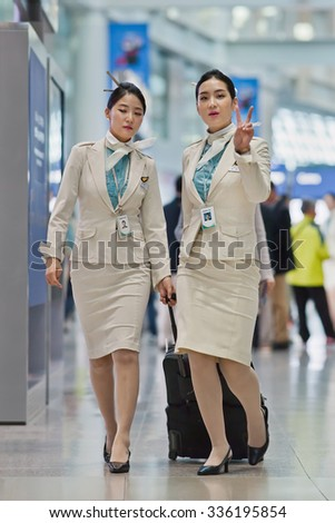 SEOUL-OCT. 24, 2015. Korean Air flight attendants. Based on fleet size, international destinations and flights, Korean Air is South Korea's largest airline. Its global headquarters is located in Seoul