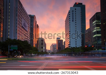 Seoul, Republic of Korea - 14 August 2014: The view of vibrant sunset over business area of Seoul with blurred traffic lights on the foreground, August 14, 2014, Seoul, Korea.