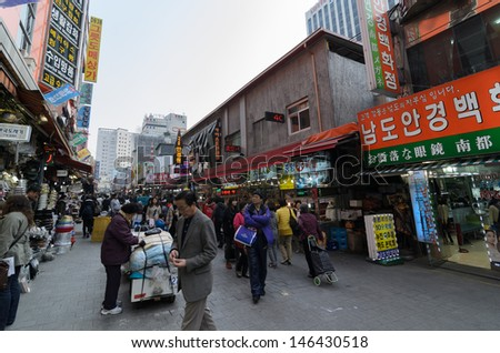 SEOUL SOUTH KOREA APRIL 6: Hawker sells goods in the Namdaemun market on april 6 2013 in Seoul South Korea. Namdaemun Market, located in the center of Seoul, is the biggest traditional market in Korea