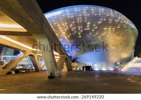 SEOUL, SOUTH KOREA - April 11: Modern architecture at the Dongdaemun Design Plaza at Night on April 11, 2015 in Seoul, South Korea. - stock photo