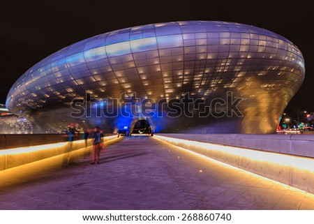 SEOUL, SOUTH KOREA - April 06: Modern architecture at the Dongdaemun Design Plaza, designed by the famous architect Zaha Hadid. Photo taken April 06, 2015 in Seoul, South Korea. - stock photo