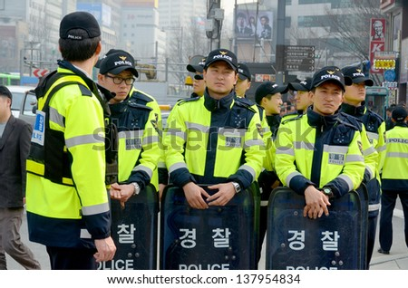 SEOUL SOUTH KOREA APRIL 6: Seoul riot police during protestation again redundancy people by a company on april 6 2013 in Seoul South Korea