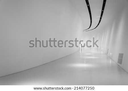 SEOUL, SOUTH KOREA - AUGUST 24: Minimalist modern architecture inside the Dongdaemun Design Plaza, designed by world renowned architect Zaha Hadid. Photo taken August 24, 2014 in Seoul, South Korea. - stock photo