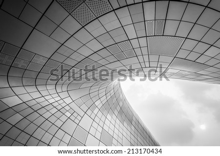 SEOUL, SOUTH KOREA - AUGUST 25: Modern architecture at the Dongdaemun Design Plaza, designed by the famous architect Zaha Hadid. Photo taken August 25, 2014 in Seoul, South Korea. - stock photo
