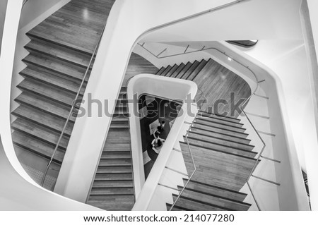 SEOUL, SOUTH KOREA - AUGUST 24: Modern architecture inside the Dongdaemun Design Plaza, designed by world renowned architect Zaha Hadid. Photo taken August 24, 2014 in Seoul, South Korea. - stock photo