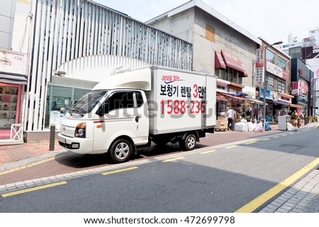 SEOUL, SOUTH KOREA -AUGUST 5: White delivery truck parked in downtown Seoul City, Korea, on AUGUST. 5, 2016.
