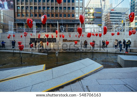 Seoul, South Korea - Dec 13, 2016: Cheonggyecheon Stream is a 10.9 km long, modern public recreation space in downtown with christmas decorations at Seoul, South Korea.