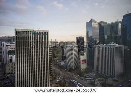 SEOUL, SOUTH KOREA - DEC 6: Modern commercial buildings in jung-gu district on December 6 2013 in Seoul, South Korea. Seoul is the capital and the largest metropolis of South Korea.  - stock photo