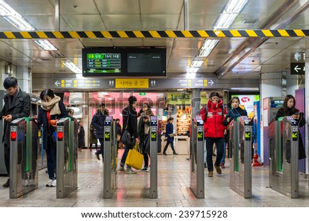 SEOUL, SOUTH KOREA - DECEMBER 21: Local Seoulites swipe their metro cards at Gangnam Station on December 21, 2014 in Seoul, South Korea.