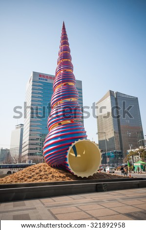 Seoul, South Korea - February 27, 2015 : Spring 2006 - By Coosje van Bruggen and Claes Oldenburg. The sculpture to mark as the Cheonggyecheon Restoration Project - stock photo