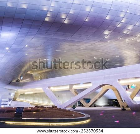 SEOUL, SOUTH KOREA - January 01:  Dongdaemun Design Plaza at Night, designed by the famous architect Zaha Hadid. Photo taken January 01, 2015 in Seoul, South Korea. - stock photo