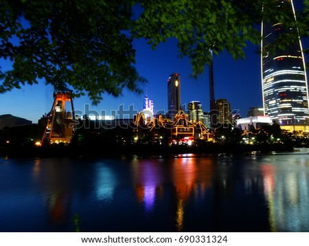Seoul, South Korea, July 25, 2017, Night view of Seokchon lake and Lotte world tower which is one of the highest building and hot spots in Seoul, Korea