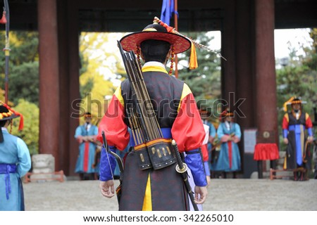 SEOUL, SOUTH KOREA - NOVEMBER 8, 2015: Armed guards in traditional costume guard the entry gate at Deoksugung Palace, a tourist landmark, in Seoul. November 8, 2015 Seoul, South Korea