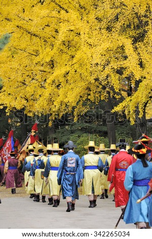 SEOUL, SOUTH KOREA - November 10, 2015: Armed guards in traditional costume guard the entry gate at Deoksugung Palace, a tourist landmark, in Seoul. November 10, 2015 Seoul, South Korea - stock photo