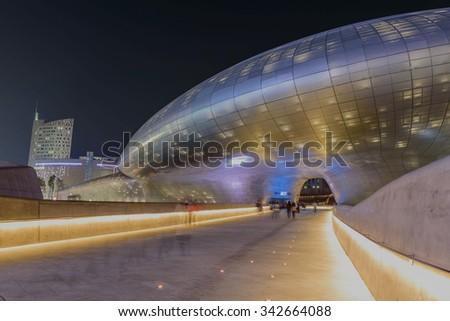 SEOUL, SOUTH KOREA - November 21: Dongdaemun Design Plaza at Night, designed by the famous architect Zaha Hadid. Photo taken November 21, 2015 in Seoul, South Korea - stock photo