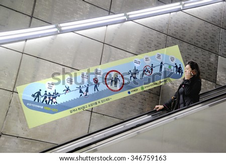 SEOUL, SOUTH KOREA - NOVEMBER 10 : Lady at escalator of Metropolitan Subway in Seoul, one of the most heavily used underground system in the world. November 10, 2015, Seoul, South Korea.