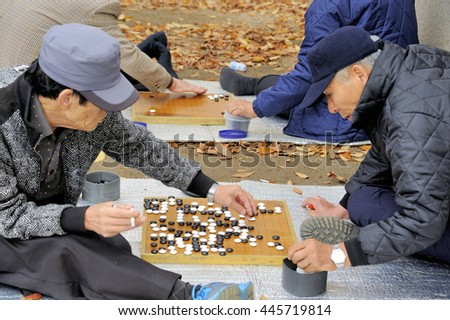 SEOUL, SOUTH KOREA-NOVEMBER 15: Men playing in the outside Baduk that is the Korean name for Go. November 15, 2015 Seoul, South Korea
