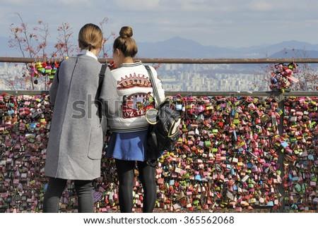 SEOUL, SOUTH KOREA - NOVEMBER 12: Thousands of love padlocks at Namsan Seoul Tower. Locks of love  which symbolize their love will be locked forever. November 12, 2015 Seoul South Korea - stock photo
