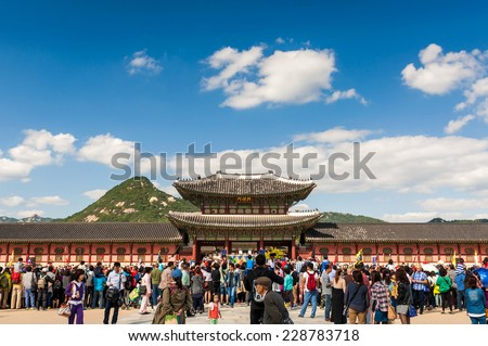 SEOUL, SOUTH KOREA - OCTOBER 4: Hundreds of tourists gather outside of Gyeongbokgung Palace on October 4, 2014 in Seoul, South Korea. - stock photo