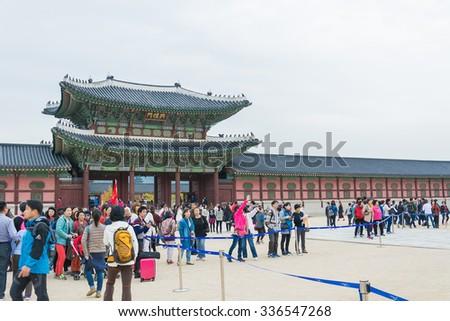 SEOUL, SOUTH KOREA - 2015 OCTOBER 26: tourists gather outside of Gyeongbokgung Palace in Seoul, South Korea. - stock photo