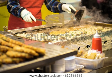SEOUL, SOUTH KOREA - One chev cooking food for sale at night market
