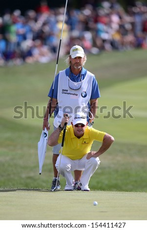 Sep 15, 2013; Lake Forest, IL, USA; Rory Sabbatini (bottom) and his caddie Kevin Fasbender line up a putt on the 18th green during the third round of the BMW Championship at Conway Farms Golf Club.