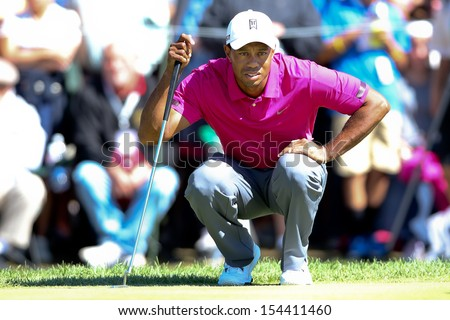 Sep 15, 2013; Lake Forest, IL, USA; Tiger Woods lines up a putt on the second green during the third round of the BMW Championship at Conway Farms Golf Club. - stock photo