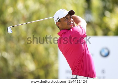 Sep 15, 2013; Lake Forest, IL, USA; Tiger Woods tees off the sixth hole during the third round of the BMW Championship at Conway Farms Golf Club. - stock photo
