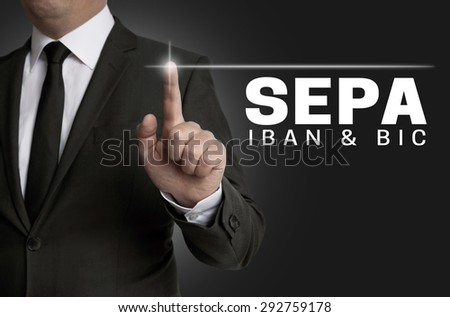 Sepa touchscreen is operated by businessman. - stock photo