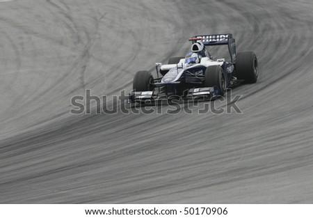SEPANG, MALAYSIA - APRIL 2 : AT&T Williams driver Rubens Barrichello of Brazil drives during Petronas Malaysian Grand Prix second practice session at Sepang F1 circuit April 2, 2010 in Sepang - stock photo