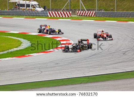 SEPANG, MALAYSIA - APRIL 10: Cars on track at race of Formula 1 GP, April 10, 2011 in Sepang, Malaysia. - stock photo