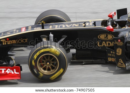 SEPANG, MALAYSIA - APRIL 8:Close-up of Nick Heidfeld of Lotus Renault GP during practice session at PETRONAS Malaysian GP on April 8, 2011 in Sepang, Malaysia. The race will be held on April 10 - stock photo