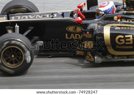 SEPANG, MALAYSIA - APRIL 8:Close-up of Vitaly Petrov of Lotus Renault GP during practice session at PETRONAS Malaysian GP on April 8, 2011 in Sepang, Malaysia. The race will be held on April 10 - stock photo