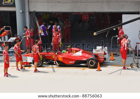 SEPANG, MALAYSIA - APRIL 8: Felipe Massa (team Scuderia Ferrari Marlboro) on the pit at first practice on Formula 1 GP, April 8 2011, Sepang, Malaysia - stock photo