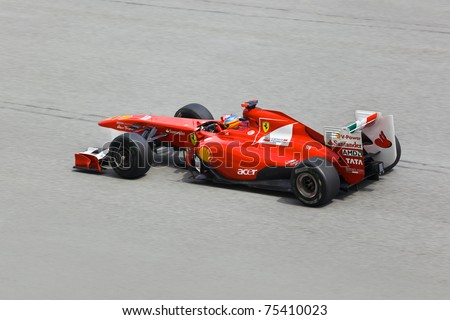 SEPANG, MALAYSIA - APRIL 8: Fernando Alonso (team Scuderia Ferrari Marlboro) at first practice on Formula 1 GP, April 8 2011, Sepang, Malaysia - stock photo
