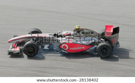 SEPANG, MALAYSIA - APRIL 3 : Heikki Kovalainen of Vodafone McLaren Mercedes brakes hard during practice session at Malaysian F1 Grand Prix April 3, 2009 at Sepang International Circuit in Sepang. - stock photo