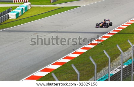 SEPANG, MALAYSIA - APRIL 8: Jaime Alguersuari (team Scuderia Toro Rosso) at first practice on Formula 1 GP, April 8 2011, Sepang, Malaysia - stock photo
